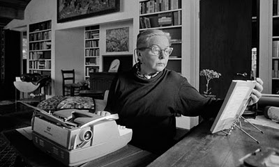 M.F.K. still at her typewriter